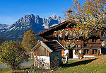 Austria, Tyrol, Kaiserwinkl: flower decorated Tyrolean farm house and Wilder Kaiser mountains