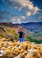 Backpacker at top of Kiger Gorge with snow and ice. Steens Mountain, Oregon.