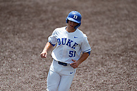 Duke Blue Devils right fielder Peter Matt (51) jogs to third base against the Liberty Flames in NCAA Regional play on Robert M. Lindsay Field at Lindsey Nelson Stadium on June 4, 2021, in Knoxville, Tennessee. (Danny Parker/Four Seam Images)