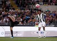 Calcio, finale Tim Cup: Milan vs Juventus. Roma, stadio Olimpico, 21 maggio 2016.<br /> Juventus' Juan Cuadrado, left, is challenged by AC Milan's Mattia De Sciglio during the Italian Cup final football match between AC Milan and Juventus at Rome's Olympic stadium, 21 May 2016.<br /> UPDATE IMAGES PRESS/Isabella Bonotto