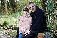 Pictured: Elly Neville with her father Lyn at their home in Pembroke, west Wales, UK. Tuesday 20 February 2018<br /> Re: Seven-year-old Elly Neville who was born despite doctors saying her parents would not be able to have any more children, has raised over £150,000 for the cancer ward that treated her father.<br /> Her parents Lyn and Ann had been told they were unlikely to have more children after he underwent a bone marrow transplant in 2005. <br /> Mr Neville subsequently spent a lot of time on the Ward 10 cancer facility at Withybush Hospital in Haverfordwest, Pembrokeshire.<br /> But four years later they were stunned when his painter and decorator wife Ann fell pregnant again.