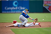 Iowa Cubs second baseman Chesny Young (9) stretches to try to receive a throw from the catcher on a stolen base attempt during a game against the Memphis Redbirds on May 29, 2017 at AutoZone Park in Memphis, Tennessee.  Memphis defeated Iowa 6-5.  (Mike Janes/Four Seam Images)