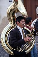 Antigua, Guatemala.  Sousaphone Player in a marching band, Semana Santa.