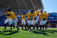 Michigan Wolverines players, including Hector Gutierrez (24), Ako Thomas (4), Marcus Chavez (12), Christan Bullock (5), Jonathan Engelmann (2), Miles Lewis (3), Jimmy Kerr (15), take the field before a game against Army West Point on February 17, 2018 at Tradition Field in St. Lucie, Florida.  Army defeated Michigan 4-3.  (Mike Janes/Four Seam Images)