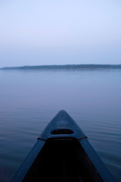 May 19, 2010. Chatham County, North Carolina.. Jug fishing is the art of tieing a baited hook and line to floating milk jugs and dropping the line into the water. After that, you just sit back and wait for the fish to bite, or not.. View of Jordan Lake from the canoe.