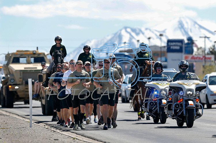 Carson City Sheriff's Office runners carry a memorial baton containing the names of 134 Nevada peace officers killed in the line of duty into Carson City, Nev., on Wednesday, May 1, 2019. Each year law enforcement representatives from around the state relay a baton from Las Vegas to Carson City for the annual Nevada Law Enforcement Officers Memorial ceremony at the capitol grounds.<br /> Photo by Cathleen Allison/Nevada Momentum