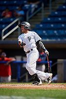 Staten Island Yankees second baseman Jesus Bastidas (2) follows through on a swing during a game against the Lowell Spinners on August 22, 2018 at Richmond County Bank Ballpark in Staten Island, New York.  Staten Island defeated Lowell 10-4.  (Mike Janes/Four Seam Images)