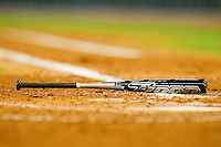 A Louisville Slugger bat lies on the ground near home plate during the game between the Utah Utes and the Baylor Bears at Minute Maid Park on March 5, 2011 in Houston, Texas.  Photo by Brian Westerholt / Four Seam Images