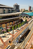 The Charlotte LYNX light rail train rides down the track near Time Warner Cable Arena in uptown Charlotte, NC.