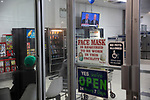 BROOKLYN, NY — SEPTEMBER 29, 2020:  The Presidential Debate between President Donald Trump and former Vice President Joe Biden is broadcast on a TV at a Laundromat on September 29, 2020 in Brooklyn, NY. Photograph by Michael Nagle