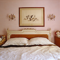 A drawing by Pandora Mond hangs above the cane-backed bed in the master bedroom