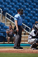 Home plate umpire Lane Cullipher works the game between the Lynchburg Hillcats and the Kannapolis Cannon Ballers at Atrium Health Ballpark on August 29, 2021 in Kannapolis, North Carolina. (Brian Westerholt/Four Seam Images)