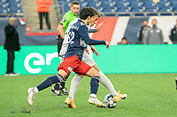 FOXBOROUGH, MA - APRIL 17: Michael Tsicoulias #52 of New England Revolution II comes in to tackle Victor Falck #23 of Richmond Kickers during a game between Richmond Kickers and Revolution II at Gillette Stadium on April 17, 2021 in Foxborough, Massachusetts.