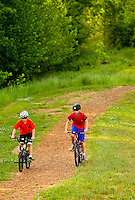 Lifestyle photography of Berewick, a 1,000-acre neighborhood development in Charlotte, NC (Steel Creek Area). Berewick was developed by Pappas Properties. Photo shows the walking / biking trail in the community.