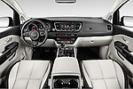 Stock photo of straight dashboard view of 2015 KIA Sedona EX 5 Door Minivan Dashboard
