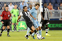 Newcastle United defender Jonas Gutierrez shields the ball from Graham Zusi Sporting KC... Sporting Kansas City and Newcastle United played to a 0-0 tie in an international friendly at LIVESTRONG Sporting Park, Kansas City, Kansas.