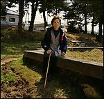 """On March 11, 2011, earthquake of magnitude 9.0 and devastating tsunami hit the Tohoku area, killing more than 15,000 people and missing more than 5,000 people. Mrs. Katsumi Saito, 69, in front of the temporary grave yard for his husband who was washed away by tsunami in front of her. """"He was hangin on to a telephone pole, but after all he was taken away by the tsunami,"""" she said. """"He wave his hands to me in the water. I could not help him.""""<br /> <br /> Le 11 mars 2011, un séisme de magnitude 9,0 et un tsunami dévastateur ont frappé la région de Tohoku, faisant plus de 15 000 morts et plus de 5 000 disparus. Mme Katsumi Saito, 69 ans, devant le cimetière temporaire de son mari qui a été emporté par le tsunami. """"Il était suspendu à un poteau téléphonique, mais après tout il a été emmené par le tsunami"""", a-t-elle déclaré. """"Il a agité ses mains dans l'eau. Je ne pouvais pas l'aider."""""""