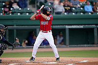 First baseman Devlin Granberg (26) of the Greenville Drive during a game against the Brooklyn Cyclones on Friday, May 14, 2021, at Fluor Field at the West End in Greenville, South Carolina. The catcher is Jose Mena (16). (Tom Priddy/Four Seam Images)
