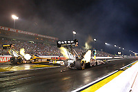 Aug 29, 2014; Clermont, IN, USA; NHRA top fuel dragster driver Shawn Langdon (right) races alongside Tony Schumacher during qualifying for the US Nationals at Lucas Oil Raceway. Mandatory Credit: Mark J. Rebilas-USA TODAY Sports