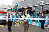 Cutting the ribbon, town mayor Jayne Ludgate (C) with Margaret Jones (L) and store manager Nicola Mangan (R)
