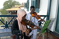 TANZANIA, Zanzibar, Stone town, Dhow countries music academy, girl and boy play violin on balcony