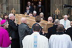 © Joel Goodman - 07973 332324 . 16/01/2014 . Salford , UK . The coffin is lead from the cathedral after the service . The funeral of Labour MP Paul Goggins at Salford Cathedral today (Thursday 16th January 2014) . The MP for Wythenshawe and Sale East died aged 60 on 7th January 2014 after collapsing whilst out running on 30th December 2013 . Photo credit : Joel Goodman