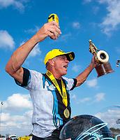 Oct 20, 2019; Ennis, TX, USA; NHRA pro stock motorcycle rider Jerry Savoie celebrates after winning the Fall Nationals at the Texas Motorplex. Mandatory Credit: Mark J. Rebilas-USA TODAY Sports