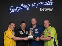 20.05.2015. London,  England. Betway Premier League Darts, Play-Offs Media Day. [L-R] Dave Chisnall, Gary Anderson,  Raymond van Barneveld, Michael van Gerwen with the Betway Premier League Trophy.