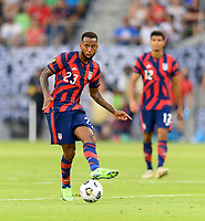 AUSTIN, TX - JULY 29: Kellyn Acosta #23 of the United States passes the ball to a teammate during a game between Qatar and USMNT at Q2 Stadium on July 29, 2021 in Austin, Texas.
