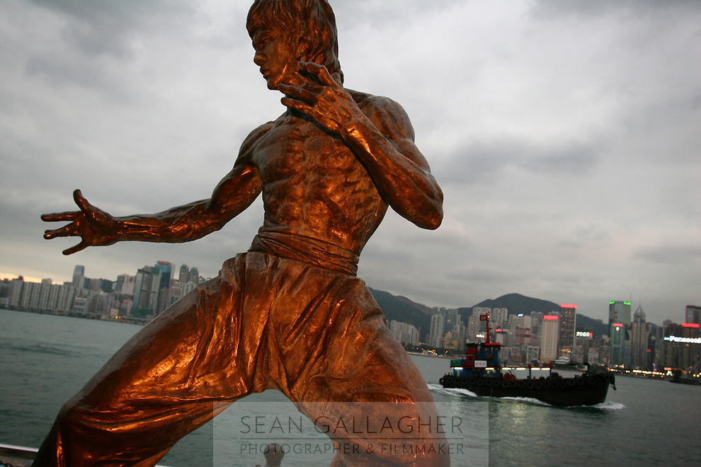 CHINA. Hong Kong. A statue of Bruce Lee, famous Hong Kong resident who became a martial arts film star in China and America during the 1970's. Officially the Hong Kong Special Administrative Region, it is a territory located on China's south coast on the Pearl River Delta. It has a population of 6.9 million people, and is one of the most densely populated areas in the world. 2008