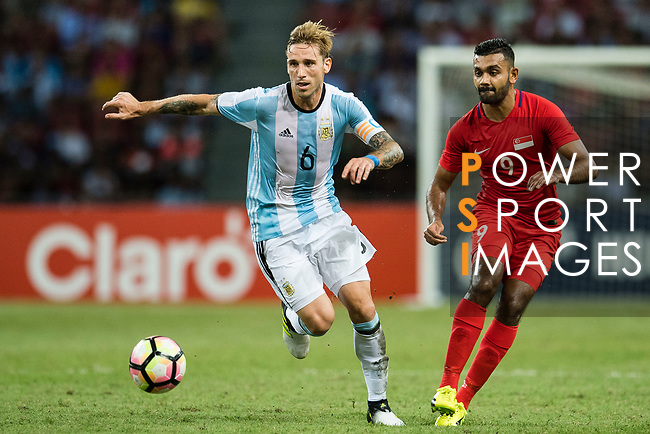 Lucas Biglia of Argentina (L) in action against Faritz Hameed of Singapore (R) during the International Test match between Argentina and Singapore at National Stadium on June 13, 2017 in Singapore. Photo by Marcio Rodrigo Machado / Power Sport Images