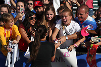 Cary, NC - Sunday October 22, 2017: Alex Morgan hand one of her autographed shoes to a fan after an International friendly match between the Women's National teams of the United States (USA) and South Korea (KOR) at Sahlen's Stadium at WakeMed Soccer Park. The U.S. won the game 6-0.