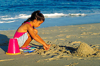 Girl playing in the sand at the beach, Cape Cod, MA