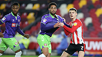 Sergi Canos of Brentford grabs the shirt of Bristol City's Zak Vyner during Brentford vs Bristol City, Sky Bet EFL Championship Football at the Brentford Community Stadium on 3rd February 2021