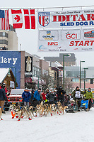 Fabio Berlusconi and team leave the ceremonial start line with an Iditarider and handler at 4th Avenue and D street in downtown Anchorage, Alaska on Saturday March 7th during the 2020 Iditarod race. Photo copyright by Cathy Hart Photography.com
