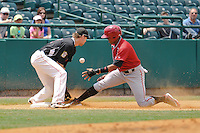 Andy Vasquez (2) of the Altoona Curve slides into third base in front of third basemen Brandon Waring during a game against the New Britain Rock Cats at New Britain Stadium on June 25, 2014 in New Britain, Connecticut.  New Britain defeated Altoona 3-1.  (Gregory Vasil/Four Seam Images)