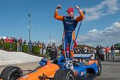 Scott Dixon, Chip Ganassi Racing Honda, celebrates race win in victory lane.