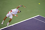 SHANGHAI, CHINA - OCTOBER 12:  David Ferrer of Spain serves to Michael Llodra of France during day two of the 2010 Shanghai Rolex Masters at the Shanghai Qi Zhong Tennis Center on October 12, 2010 in Shanghai, China.  (Photo by Victor Fraile/The Power of Sport Images) *** Local Caption *** David Ferrer