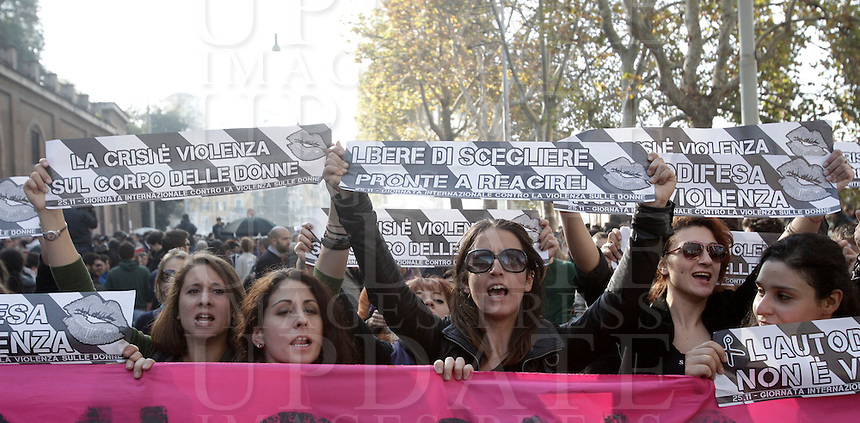 """Studenti manifestano contro le politiche di austerita' del governo, a Roma, 24 novembre 2012..Demonstrators hold signs reading """"Self-defense is not violence"""", """"Free to choose, ready to react"""" and """"Crisis is violence on women's bodies"""" against male violence on women, during a protest against government austerity measures, in Rome, 24 November 2012..UPDATE IMAGES PRESS/Riccardo De Luca"""