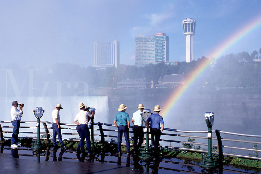 rainbow, NY, Niagara Falls, waterfalls, New York, Tourists look at the rainbow from the observation point over Horseshoe Falls on the Canadian side.