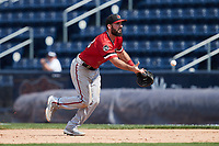 Jake Noll (18) of the Rochester Red Wings flips the ball towards first base during the game against the Scranton/Wilkes-Barre RailRiders at PNC Field on July 25, 2021 in Moosic, Pennsylvania. (Brian Westerholt/Four Seam Images)