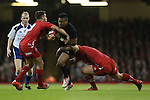 Wales pair Rhys Webb and Paul James combine to stop All Blacks wing Julian Savea.<br /> Dove men Series 2014<br /> Wales v New Zealand<br /> 22.11.14<br /> ©Steve Pope -SPORTINGWALES