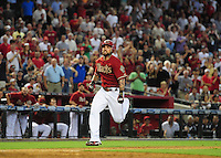 Jun. 20, 2012; Phoenix, AZ, USA; Arizona Diamondbacks third baseman Ryan Roberts runs home on his way to scoring a two run inside the park home run in the sixth inning against the Seattle Mariners at Chase Field.  Mandatory Credit: Mark J. Rebilas-