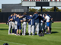 Calvary Christian Academy Eagles team huddle after a game against the IMG Academy Ascenders on March 13, 2021 at IMG Academy in Bradenton, Florida.  (Mike Janes/Four Seam Images)