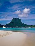 Bora Bora, French Polynesia   <br /> View of Bora Bora across the tropocal waters of Bora Bora lagoon from an atol beach of Motu Piti Uu Tai,  Taahina Bay