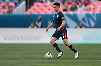 DENVER, CO - JUNE 3: Antonee Robinson #5 of the United States dribbles with the ball during a game between Honduras and USMNT at EMPOWER FIELD AT MILE HIGH on June 3, 2021 in Denver, Colorado.