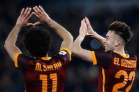 Calcio, Serie A: Roma vs Fiorentina. Roma, stadio Olimpico, 4 marzo 2016.<br /> Roma's Stephan El Shaarawy, right, celebrates with teammate Mohamed Salah after scoring during the Italian Serie A football match between Roma and Fiorentina at Rome's Olympic stadium, 4 March 2016.<br /> UPDATE IMAGES PRESS/Riccardo De Luca