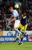 Thursday 08 August 2013<br /> Pictured L-R: Pontus Jansson of Malmo battles for a header against Wilfried Bony of Swansea. <br /> Re: Malmo FF v Swansea City FC, UEFA Europa League 3rd Qualifying Round, Second Leg, at the Swedbank Stadium, Malmo, Sweden.