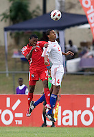 Adrian Diz (4) of Cuba goes up for a header against Dario Wright (7) of Panama during the group stage of the CONCACAF Men's Under 17 Championship at Jarrett Park in Montego Bay, Jamaica. Panama tied Cuba, 0-0.