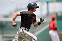 GCL Orioles shortstop Andrew Fregia (19) runs to first base during a game against the GCL Red Sox on August 9, 2018 at JetBlue Park in Fort Myers, Florida.  GCL Red Sox defeated GCL Orioles 10-4.  (Mike Janes/Four Seam Images)